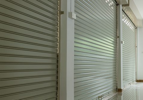 roller shutter door in warehouse building, aluminium steel metal door